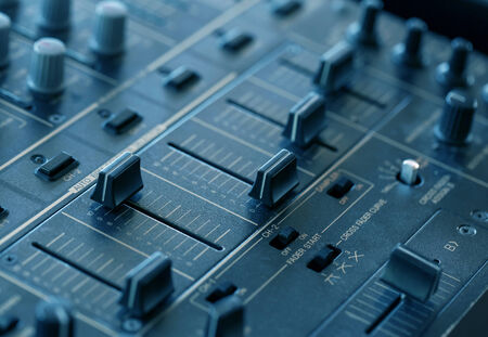 Dj sound mixer  with knobs and sliders, closeup