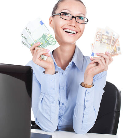 Smilling businesswoman on workplace with euros in hands photo