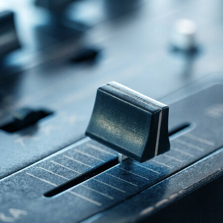 crossfader: Crossfader on dj mixer in club, closeup