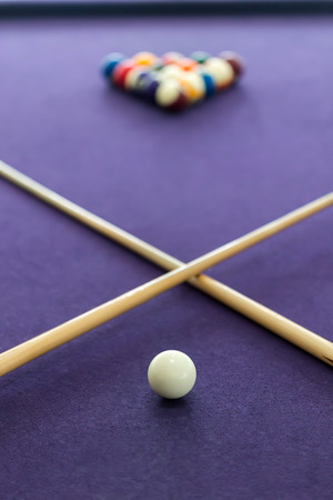 Billiard table with balls arranged in a triangle photo