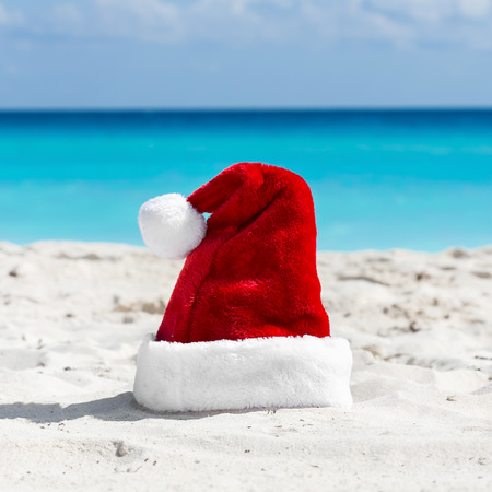 bahamas celebration: Santa Claus hat at caribbean sandy beach, Cancun. Holiday concept