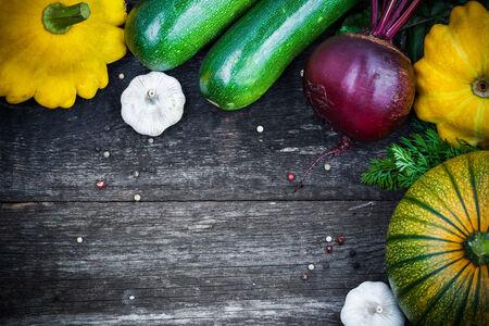 cucurbit: Fresh organic seasonal vegetables - pumpkin, squash, beetroot on wooden background