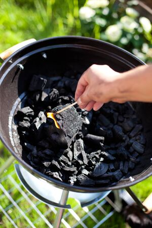 matchstick: Striking a matchstick, burn up a charcoal in barbecue grill