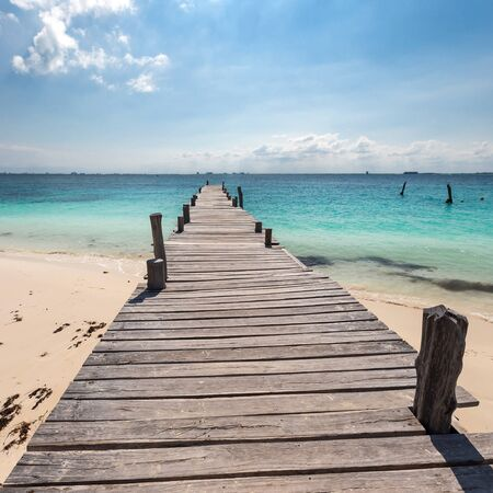 sand harbor: Wooden pier on tropical beach, Mexico, Cancun