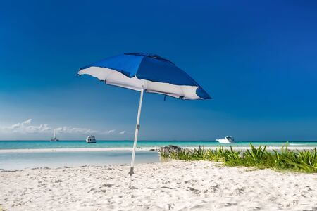 cancun: Sun umbrella on caribbean beach, Cancun, Mexico Stock Photo