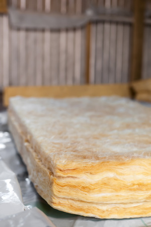 glasswool: Mineral wool is ready to thermally insulating house attic