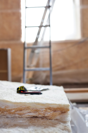 Thermally insulating house attic with mineral wool