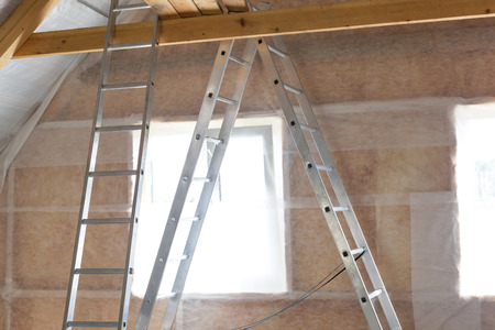 Inside wall insulation in wooden house,  building under construction photo