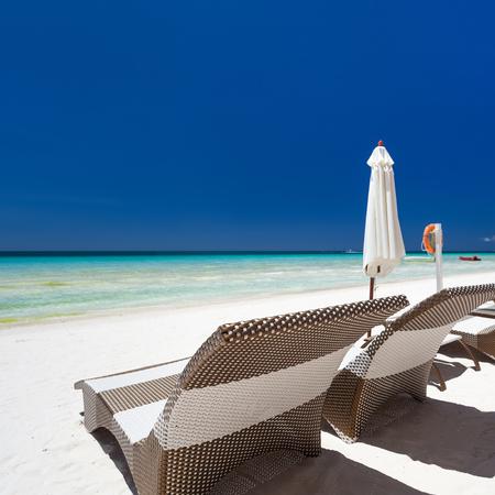 sun umbrellas: Sun umbrellas and beach chairs on a beautiful island, Philippines, Boracay