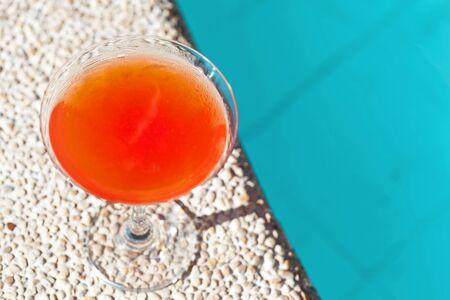 Cocktail Margarita with ice near swiming pool, nobody photo