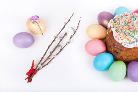 Easter cake and painted eggs closeup on white background photo