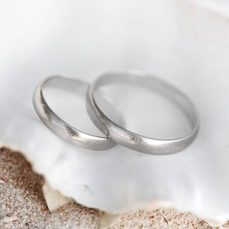 Celebration Valentines day on beach, rings on shell photo