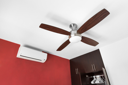 fan ceiling: Electric ceiling fan and split-system air conditioner at the room