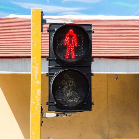 Red pedestrian traffic light in the city photo