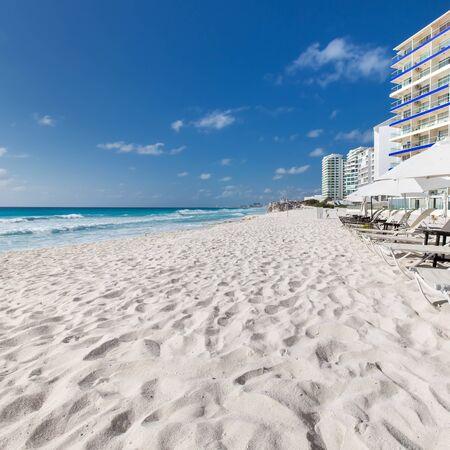 sun umbrellas: Caribbean beach with sun umbrellas and beds. Vacation concept