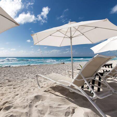 sun umbrellas: Caribbean beach with sun umbrellas and beds
