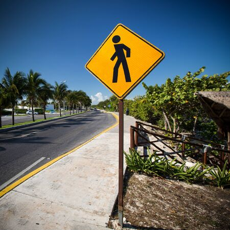 pedestrian crossing: Pedestrian crossing sign on tropical street Stock Photo