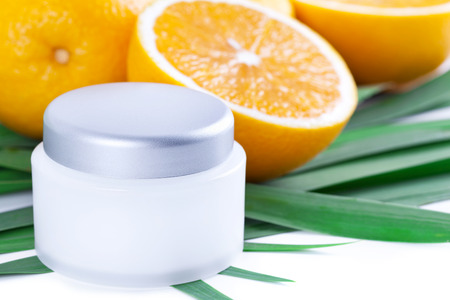 revitalizing: Facial cream with vitamin C, Orange fruit skincare Stock Photo