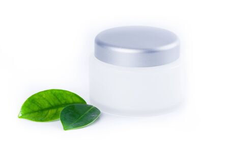 Organic cosmetic facial products with fresh green leaves