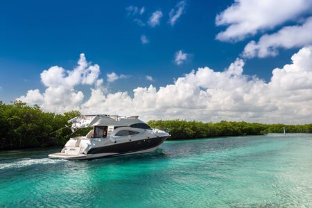 Luxury private motor yacht sailing out at sea
