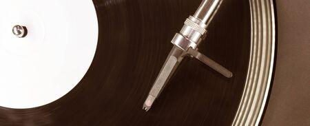 stylus: Dj needle stylus on spinning record, closeup
