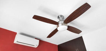 ceiling: Electric ceiling fan and split-system air conditioner at the room
