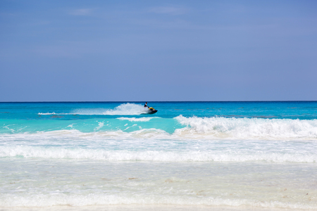 cruis: MEXICO, CANCUN - 18 MARCH 2015: Young man riding jet ski on caribbean sea Editorial