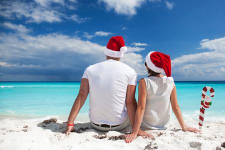 beach happy new year: Happy couple celebrating Christmas on beach