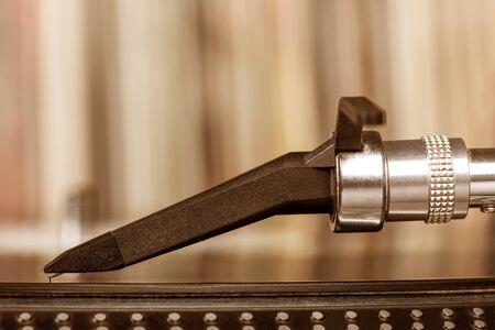 stylus: Dj needle stylus on spinning record, vinyl background Stock Photo