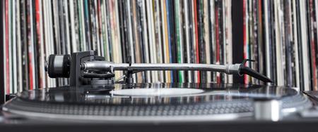 Dj turntable on vinyl background, closeup
