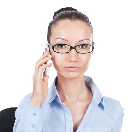 Businesswoman on workplace with phone in hand photo