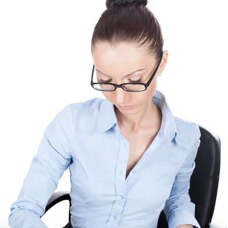 Businesswoman on workplace in glasses photo