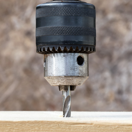 hand drill: Drilling wooden plank with hand drill, closeup