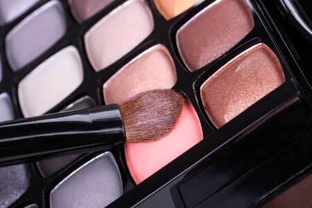 neutral: Neutral eyeshadows palette with professional brush, closeup Stock Photo