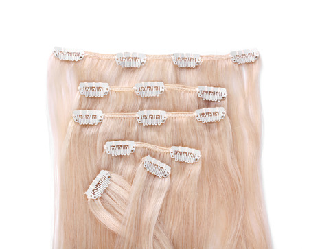 uncombed: Blond hair extension, closeup on white