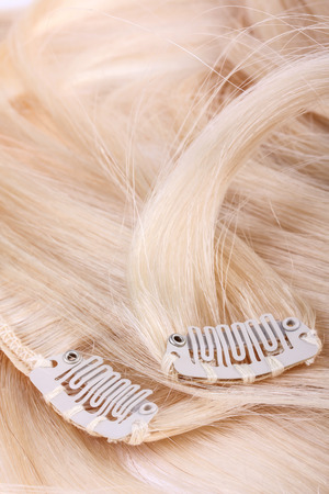 uncombed: Blond hair extension, clips details Stock Photo