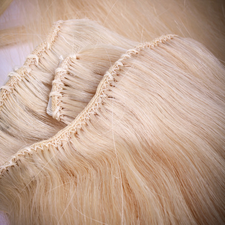uncombed: Blond hair extension, macro