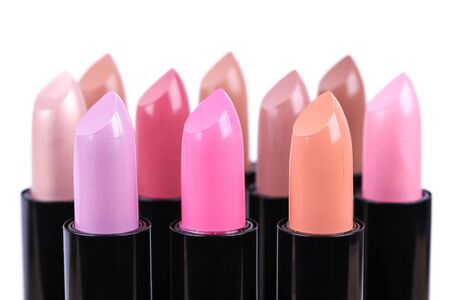 align: Align lipsticks different colours, closeup on white Stock Photo