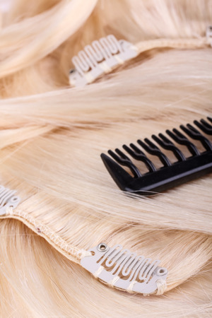 uncombed: Hair extensions, clips and brush Stock Photo