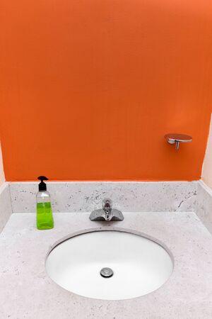 to sink: Bathroom sink at restroom interior Stock Photo
