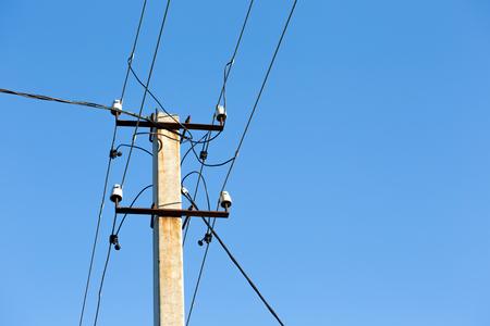 torres el�ctricas: High-voltage electricity pylons against blue sky