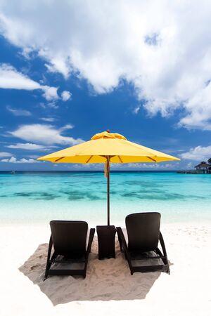 sun umbrella: Sun umbrella and beach beds on tropical beach