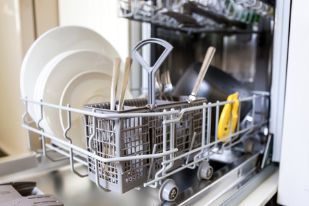 wash dishes: Open dishwasher with clean glass and dishes, selective focus