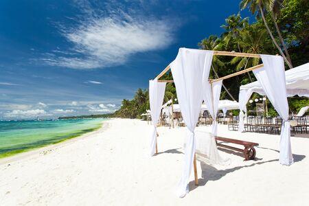 bahamas celebration: Wedding decorated  gate on tropical sandy beach near turquoise sea