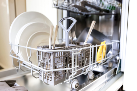 dishes: Open dishwasher with clean glass and dishes, selective focus