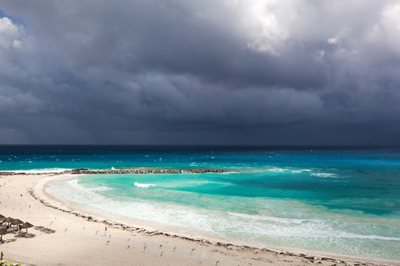 caribbean beach: Stormy weather in Cancun, beautiful turquoise sea under dark blue clouds, view from above