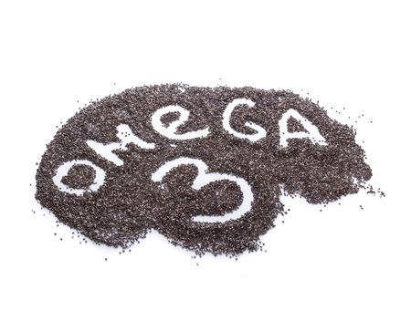 semilla: Palabra OMEGA-3 escrito a mano a partir de semillas de ch�a en blanco enfoque selectivo. Chia semillas es una fuente de aceite vegetal de Omega para las personas vegetarianas Foto de archivo