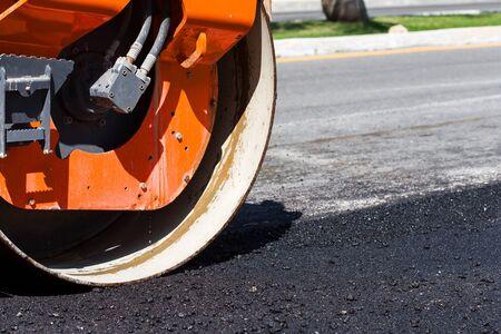 steamroller: Detail of steamroller during road construction. Asphalt pavement works