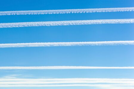 carcinogen: Jet trails, known as chemtrails over blue sky