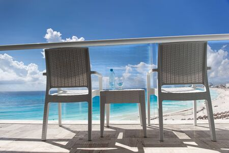 seaview: Balcony with wicker chairs and table overlooking an ocean